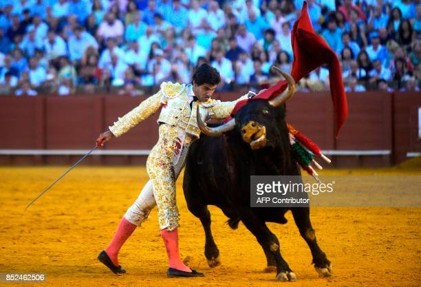 Spanish matador Pablo Aguado performs a pass with muleta on a bull during a bullfight at the Maestranza bullring in Sevilla on September 23 2017 /...
