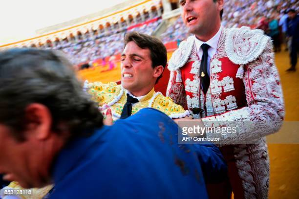 Spanish matador Rafael Serna is evacuated after being gored by a bull during a bullfight at the Maestranza bullring in Sevilla on September 24 2017 /...