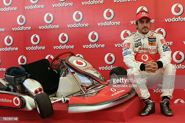 Spanish McLaren Mercedes Formula One driver Fernando Alonso poses next to a gokart during a promotional event as part of the Vodafone Gokart Cup 2007...