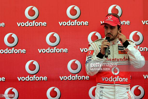 Spanish McLaren Mercedes Formula One driver Fernando Alonso talks to the media during a promotional event as part of the Vodafone Gokart Cup 2007 in...