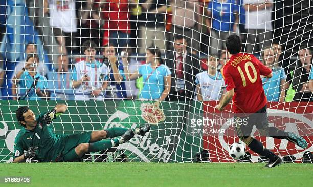 Spanish midfielder Cesc Fabregas scores the last goal on penalty against Italian goalkeeper Gianluigi Buffon during the Euro 2008 Championships...