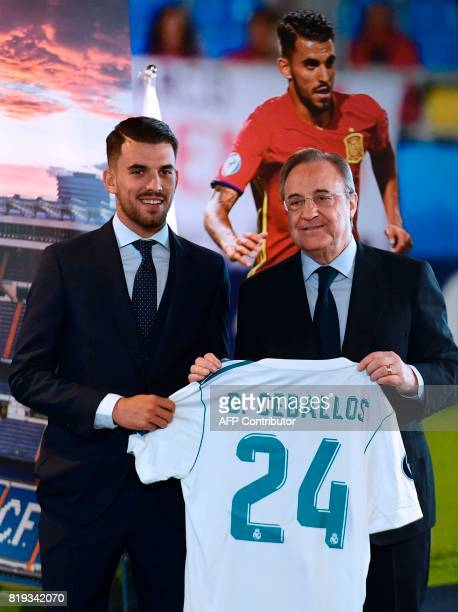 Spanish midfielder Dani Ceballos poses with his new jersey and Real Madrid's President Florentino Perez during his presentation as new football...