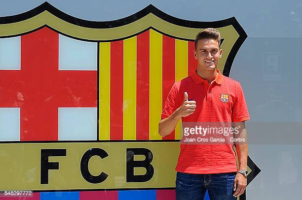 Spanish midfielder Denis Suárez poses in front of the FCBarcelona shield after signing for FCBarcelona on July 5 2016 in Barcelona Spain