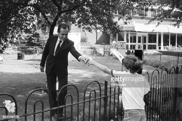 Spanish mime artist Alberto Vidal receives a banana from eight year old Rufus Williams whilst taking part in an Urban Man exhibition at London Zoo