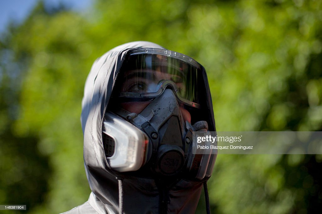 A Spanish miner wearing a tear gas mask looks on during clashes with riot police at the Soton mine June 15, 2012 in El Entrego, near Oviedo in northern Spain. Spanish coal miners are staging a nationwide strike organised by unions opposed to subsidy reductions from 300 million to 110 million Euros.
