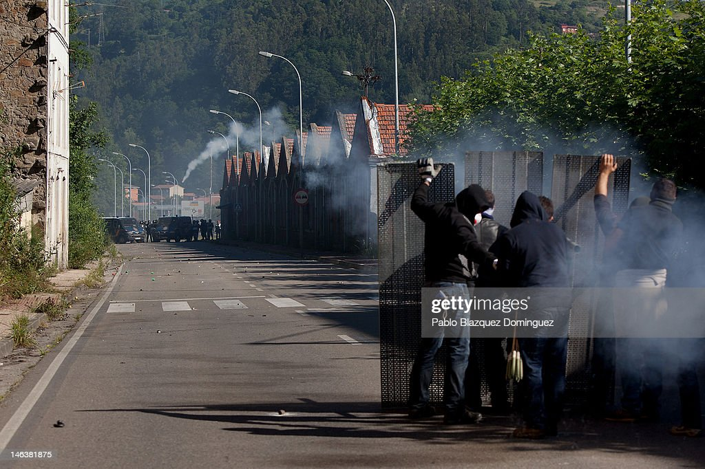 Spanish miners launch firecrackers at riot police at the Soton mine June 15, 2012 in El Entrego, near Oviedo in northern Spain. Spanish coal miners are staging a nationwide strike organised by unions opposed to subsidy reductions from 300 million to 110 million Euros.
