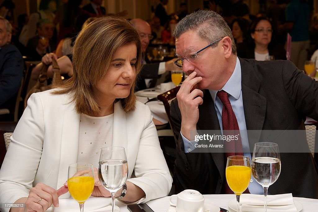 Spanish Minister of Employment and Social security Maria <a gi-track='captionPersonalityLinkClicked' href=/galleries/search?phrase=Fatima+Banez&family=editorial&specificpeople=8764943 ng-click='$event.stopPropagation()'>Fatima Banez</a> Garcia (L) and Spanish Minister of Justice Alberto Ruiz Gallardon (R) attend the 'Los Desayunos de Europa Press' conference at the Villamagna Hotel on July 4, 2013 in Madrid, Spain.