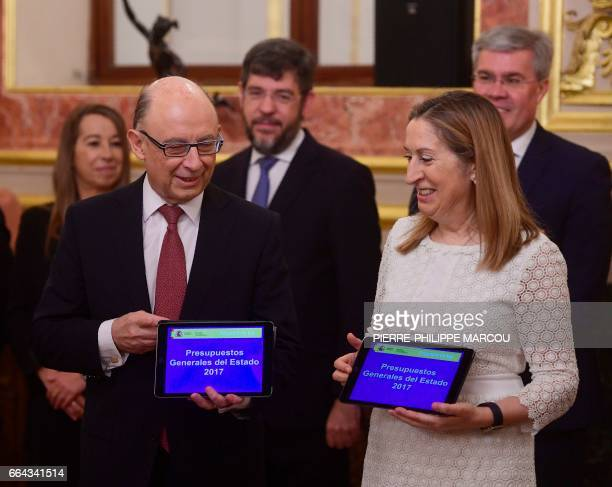 Spanish Minister of Finance and Public Services Cristobal Montoro and President of the Congress Ana Pastor present the 2017 general state budget...