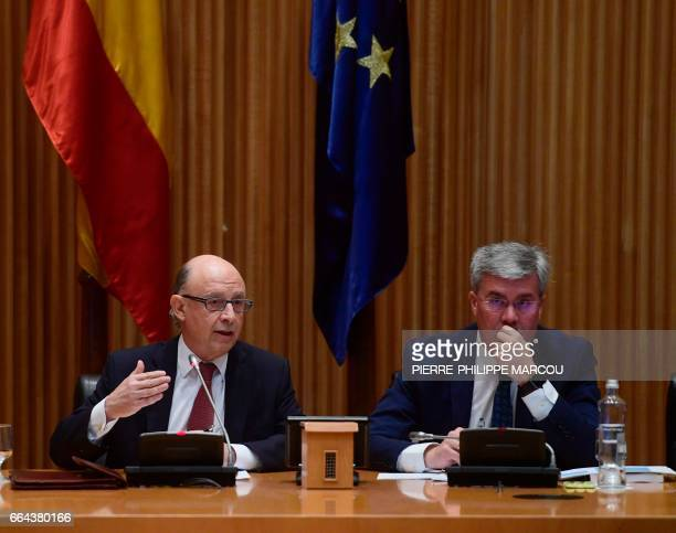 Spanish Minister of Finance and Public Services Cristobal Montoro and State secretary Jose Enrique Fernandez attend a press conference during...