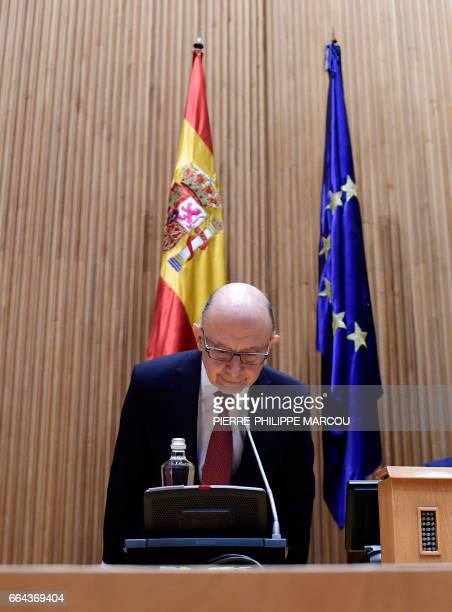 Spanish Minister of Finance and Public Services Cristobal Montoro arrives to a press conference during presentation of the 2017 general state budget...