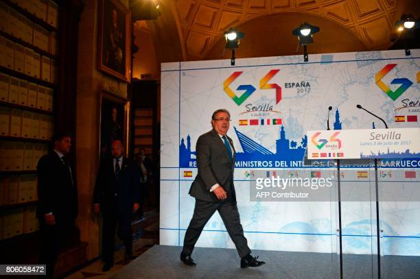Spanish Minister of Interior Juan Ignacio Zoido arrives for a press conference at the 'Archivo de Indias' in Seville on July 3 during the G4 summit...