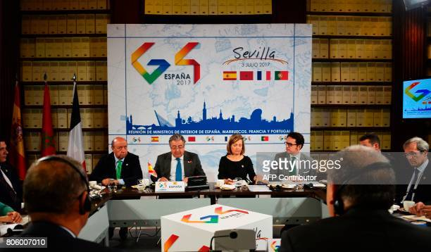 Spanish Minister of Interior Juan Ignacio Zoido reads a document during a meeting the 'Archivo General de Indias' in Seville on July 3 during the G4...