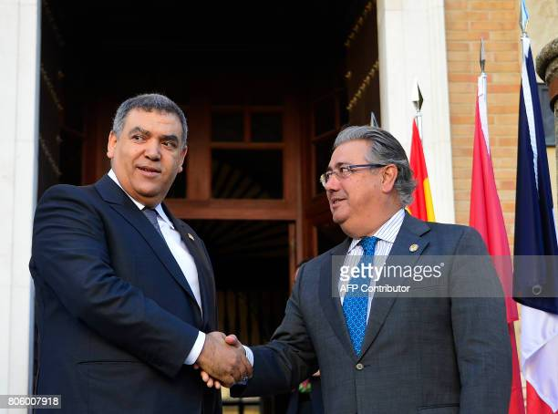 Spanish Minister of Interior Juan Ignacio Zoido shakes hands with Moroccan Minister of Interior Abdelouafi Laftit before a meeting at the 'Archivo...