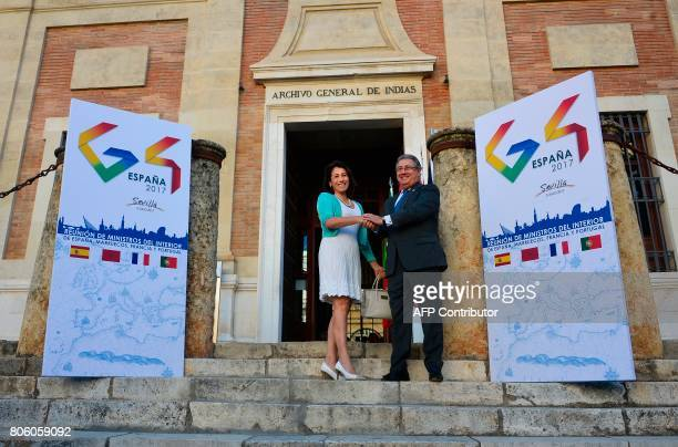 Spanish Minister of Interior Juan Ignacio Zoido shakes hands with Portuguese Minister of Interior Constança Urbano de Sousa before a meeting at the...