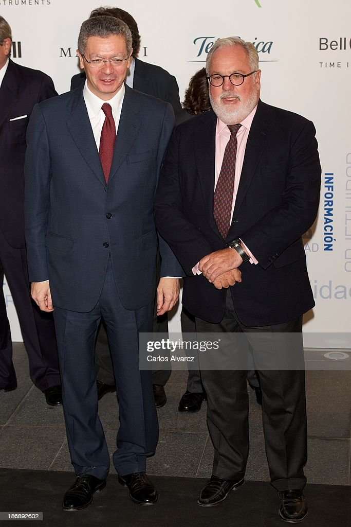 Spanish Minister of Justice Alberto Ruiz Gallardon (L) and Spain's Minister for Agriculture Miguel Arias Canete (R) attend 'La Razon' Newspaper 15th Anniversary on November 4, 2013 in Madrid, Spain.