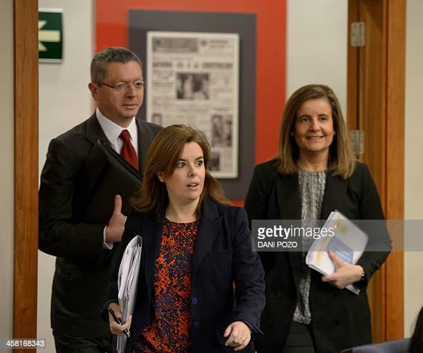 Spanish Minister of Justice Alberto RuizGallard VicePrime Minister Soraya Saenz de Santamaria and Minister of Employment and Social Security Fatima...