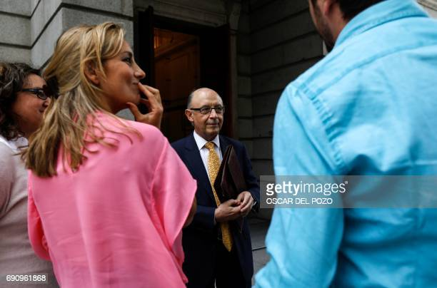 Spanish Minister of the Treasury and Public Function Cristobal Montoro speaks with journalists before the parliamentary session held to vote the 2017...