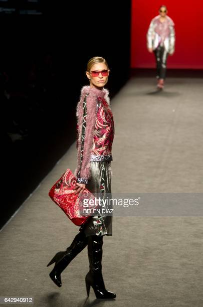 Spanish model Carla Pereira presents a creation from Custo Barcelona's Autumn/Winter 2018 collection during the MercedesBenz Madrid Fashion Week in...