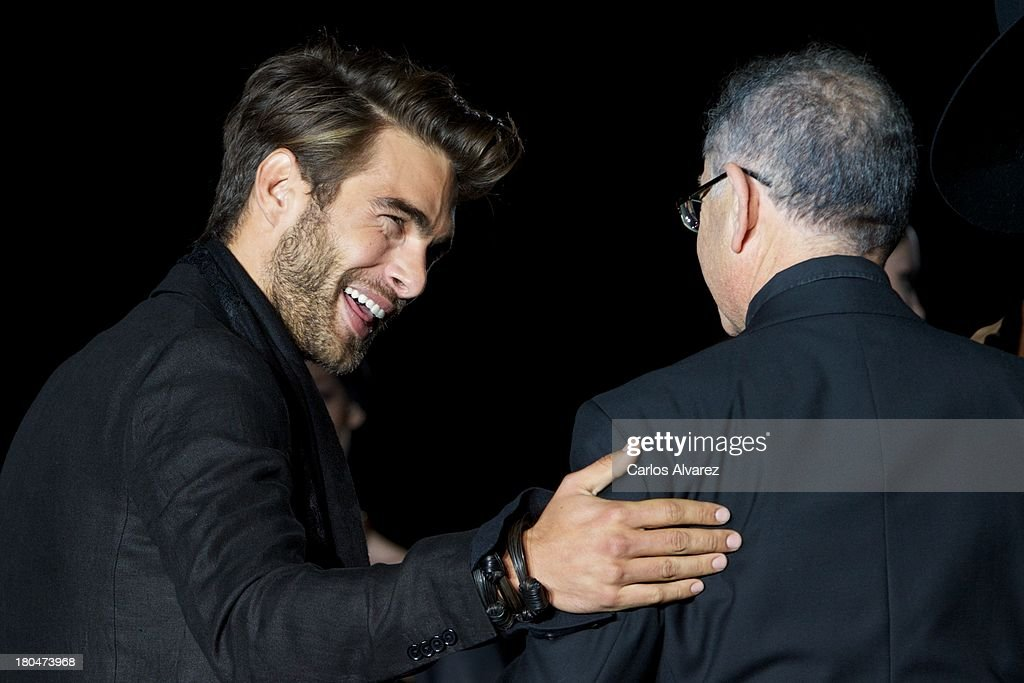 Spanish model <a gi-track='captionPersonalityLinkClicked' href=/galleries/search?phrase=Jon+Kortajarena&family=editorial&specificpeople=4684429 ng-click='$event.stopPropagation()'>Jon Kortajarena</a> (L) and Spanish designer Roberto Verino (R) walk the runway at the Roberto Verino show during Mercedes Benz Fashion Week Madrid Spring/Summer 2014 at Ifema on September 13, 2013 in Madrid, Spain.
