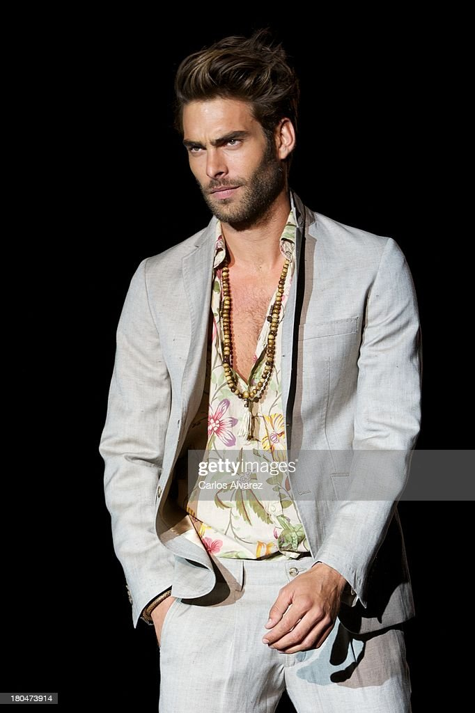 Spanish model <a gi-track='captionPersonalityLinkClicked' href=/galleries/search?phrase=Jon+Kortajarena&family=editorial&specificpeople=4684429 ng-click='$event.stopPropagation()'>Jon Kortajarena</a> showcases designs by Roberto Verino on the runway at Roberto Verino show during Mercedes Benz Fashion Week Madrid Spring/Summer 2014 at Ifema on September 13, 2013 in Madrid, Spain.