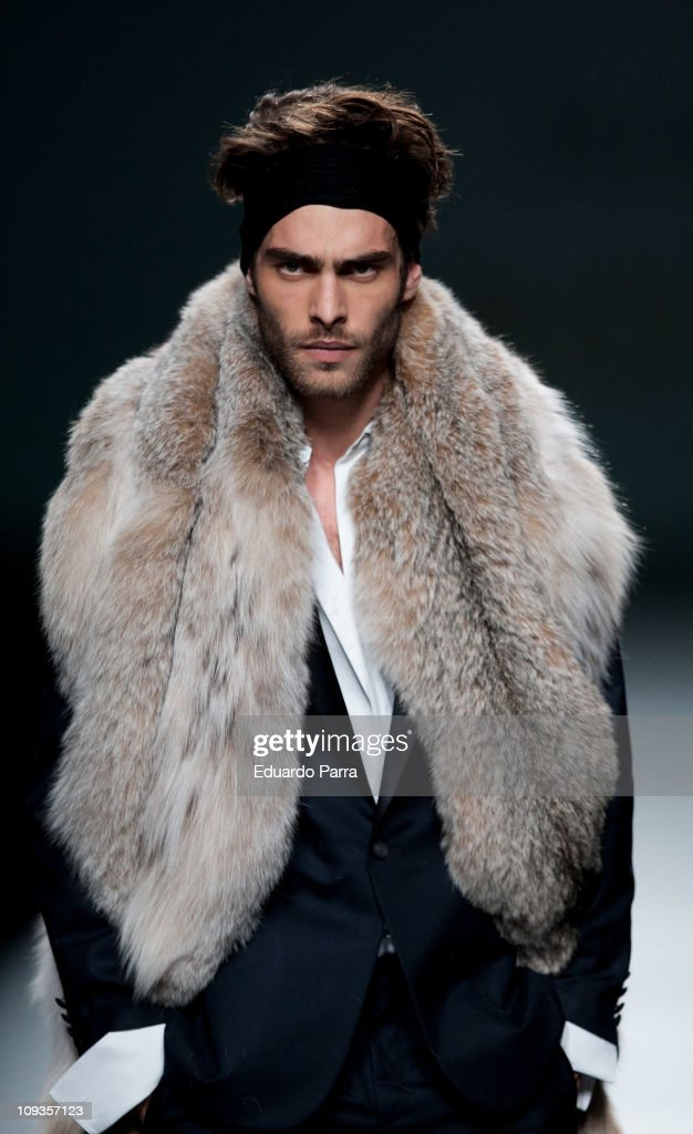 Spanish model Jon Kortajarena walks the runway during the Jesus Lorenzo Fashion Show as part of Cibeles Fashion Week A/W 2011 on February 22 2011 in...