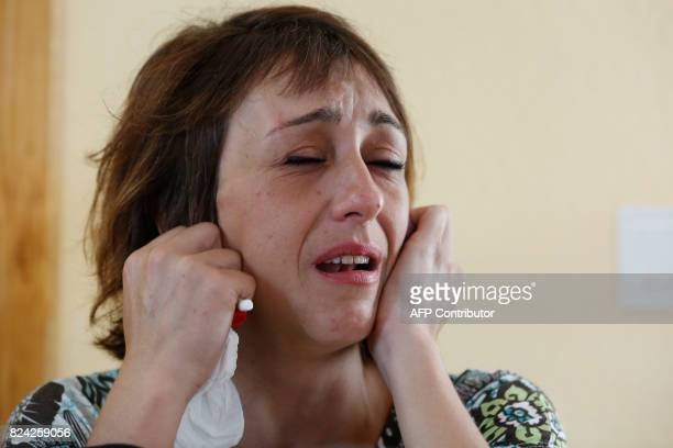 Spanish mother Juana Rivas cries during a press conference in Maracena on July 25 2017 Juana Rivas a woman in her mid30s from Maracena in southern...