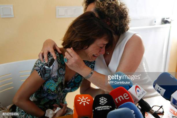 Spanish mother Juana Rivas is comforted by Spanish Juana Rivas and equality manager at Maracena women's center Francisca Granados during a press...