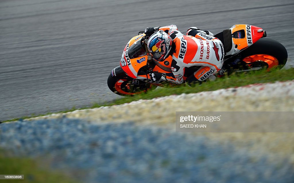 Spanish Moto GP rider Dani Pedrosa of the Repsol Honda Team negotiates at a curve on the third and final day of the pre-season test at the Sepang circuit outside Kuala Lumpur on February 7, 2013. AFP PHOTO / Saeed Khan