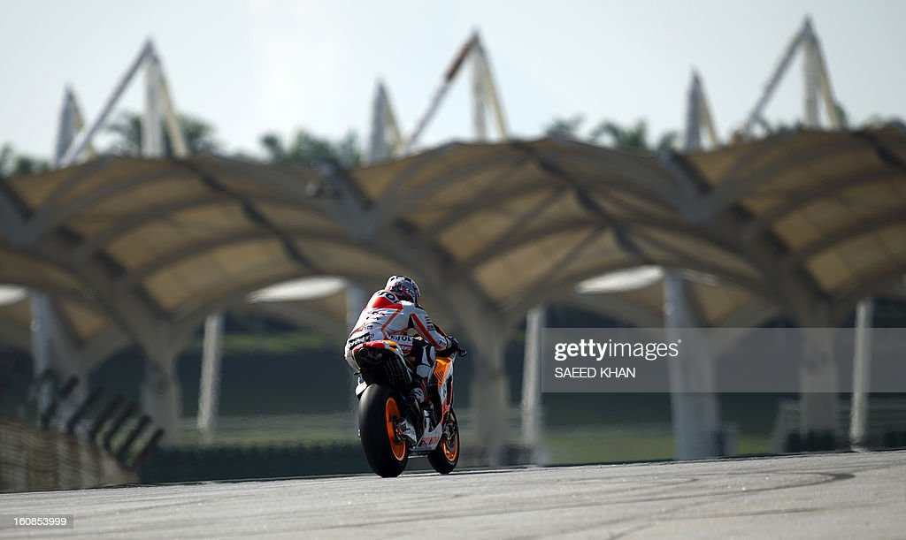 Spanish Moto GP rider Dani Pedrosa of the Repsol Honda Team powers his bike on the third and final day of the pre-season test at the Sepang circuit outside Kuala Lumpur on February 7, 2013. AFP PHOTO / Saeed Khan