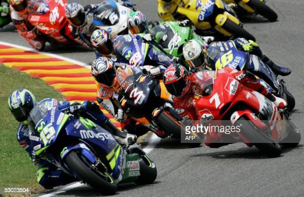 Spanish Moto GP rider Sete Gibernau leads the pack at the start of the Italian Grand Prix at Mugello's circuit 05 June 2005 Italian Valentino Rossi...