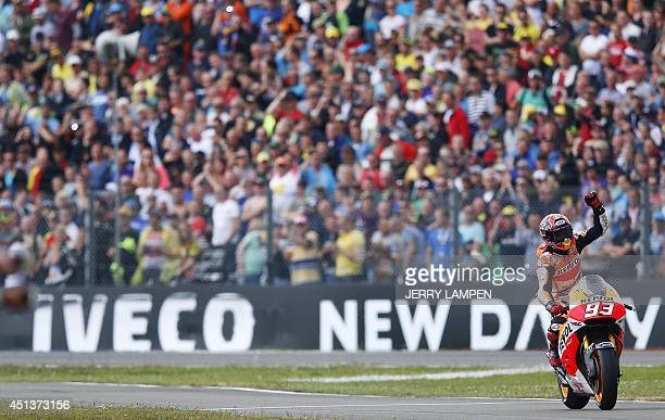 Spanish MotoGP rider Marc Marquez celebrates after winning the Motorcycling Grand Prix of Assen at the TT circuit in Assen northern Netherlands on...