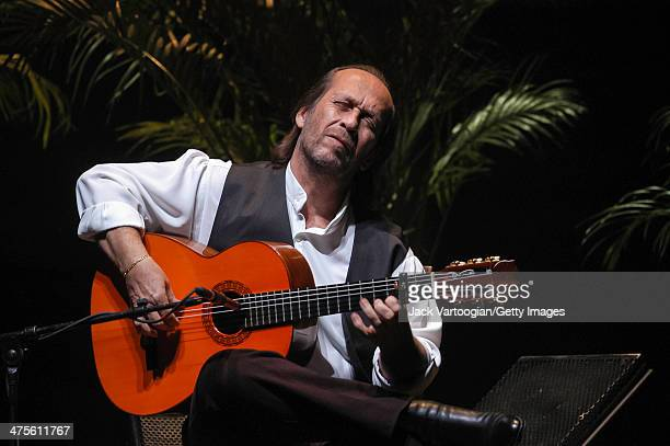 Spanish musician Paco de Lucia plays guitar during the World Music Institute 'Flamenco Festival New York 2004' concert at the Beacon Theater New York...