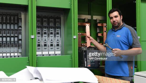 Spanish national 31yearold Jose Ramon Avendano Fuentes poses at his workplace in the Electrical systems company 'Zach Elektroanlagen' in the small...