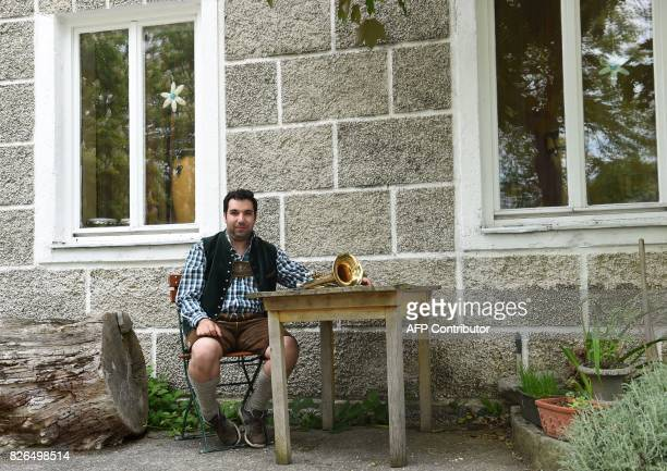 Spanish national 31yearold Jose Ramon Avendano Fuentes poses wearing traditional Bavarian clothes the small Bavarian village of Emertsham southern...