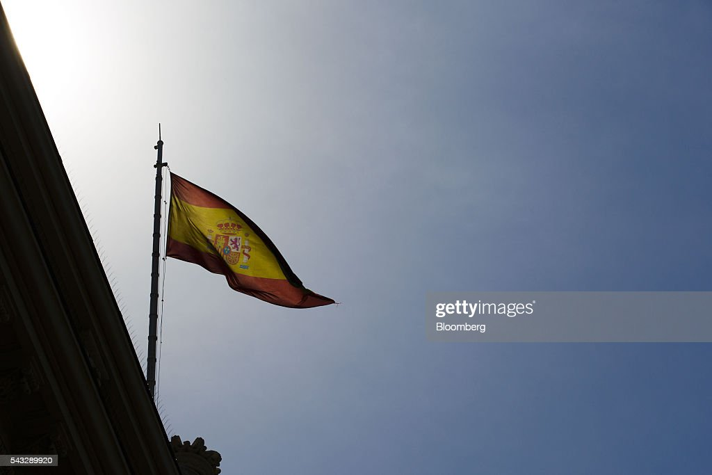 A Spanish national flag flies above the Madrid stock exchange, also known as Bolsas y Mercados Espanoles, in Madrid, Spain, on Monday, June 27, 2016. Spanish government bonds jumped, pushing the yield down by the most in eight months, after Acting Prime Minister Mariano Rajoy defied opinion polls to consolidate his position in the country's general election after Brexit rocked the world's financial markets last week. Photographer: Angel Navarrete/Bloomberg via Getty Images