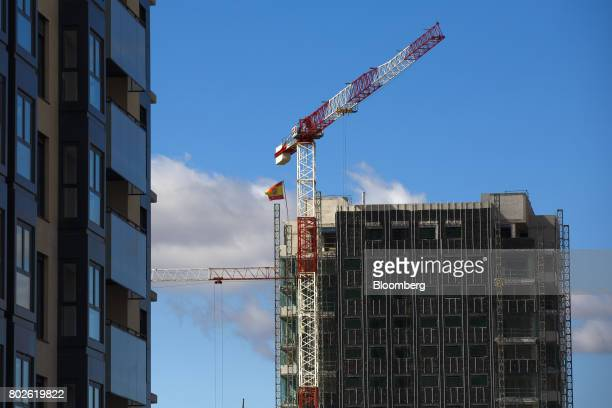 A Spanish national flag flies from the top of a new residential tower block under construction in Madrid on Wednesday June 28 2017 Bankia SA agreed...