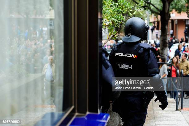Spanish national police officers during the Catalonia independence referendum declared ilegal by the Spanish government on October 1 2017 in...
