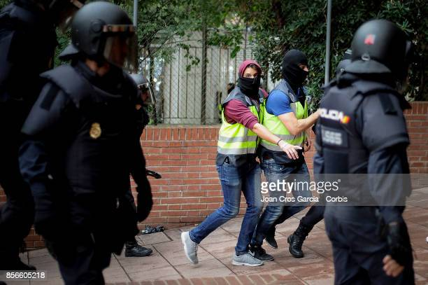 Spanish national police officers running during the Catalonia independence referendum declared ilegal by the Spanish government on October 1 2017 in...