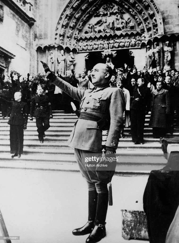 Spanish Nationalist leader General <a gi-track='captionPersonalityLinkClicked' href=/galleries/search?phrase=Francisco+Franco&family=editorial&specificpeople=190209 ng-click='$event.stopPropagation()'>Francisco Franco</a> (1892 - 1975) salutes during the singing of the Nationalist national anthem at Burgos Cathedral, Castile, Spain, 24th November 1938. He is attending a holy mass in memory of José Antonio Primo de Rivera (1903 - 1936), founder of the Falange Española, the only legal political party in Francoist Spain.