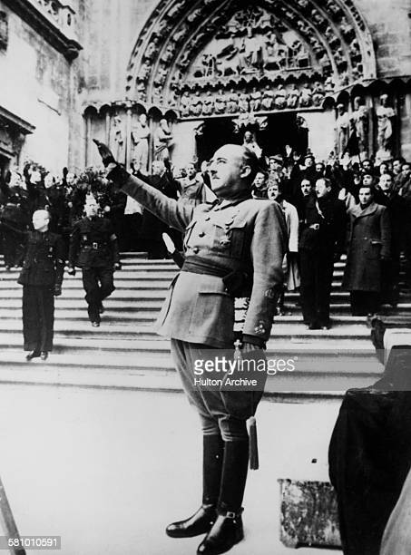 Spanish Nationalist leader General Francisco Franco salutes during the singing of the Nationalist national anthem at Burgos Cathedral Castile Spain...