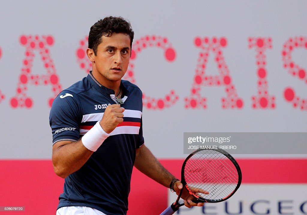 Spanish Nicolas Almagro celebrates after winning a point against Argentinian Leonardo Mayer during their quarter-final Estoril Open Tennis tournament in Estoril on April 29, 2016. / AFP / JOSE