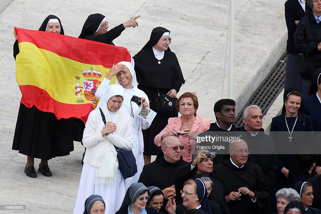 Spanish nuns wave as Pope Benedict XVI attends a mass for the opening of the Synod of Bishops on October 7, 2012 in Vatican City, Vatican. Pontiff named today Spanish St John of Avila and German St Hildegard of Bingen as 'Doctors of the Church'.