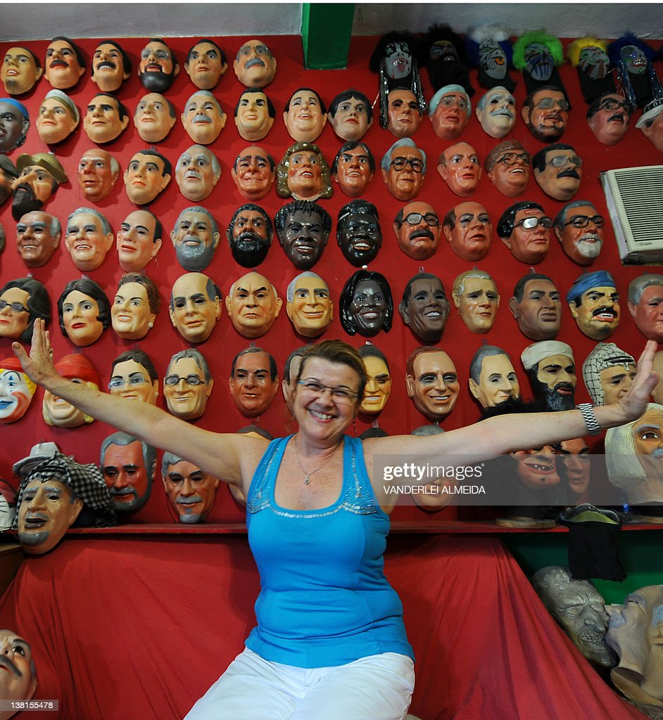 Spanish Olga Gibert, 50, owner of Condal carnival masks factory poses with some examples of their products, in Sao Goncalo, 35 km from dowtown Rio de Janeiro, Brazil, on February 3, 2012.