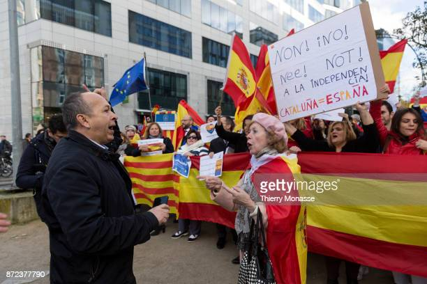 Spanish opponents of the independence of Catalonia protest as Catalan proindependence mayors hold a banner as they demonstrate in support of detained...