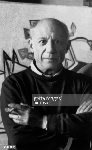 Spanish painter Pablo Picasso poses in the 1960s in his atelier in Mougins south of France AFP PHOTO RAPH GATTI