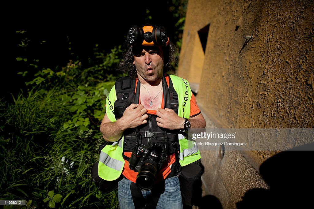 Spanish photo journalist Jose Ramon Silveira, 47, gestures after being hit in the chest by a rubber bullet from riot police at the Soton mine June 15, 2012 in El Entrego, near Oviedo in northern Spain. Spanish coal miners are staging a nationwide strike organised by unions opposed to subsidy reductions from 300 million to 110 million Euros.