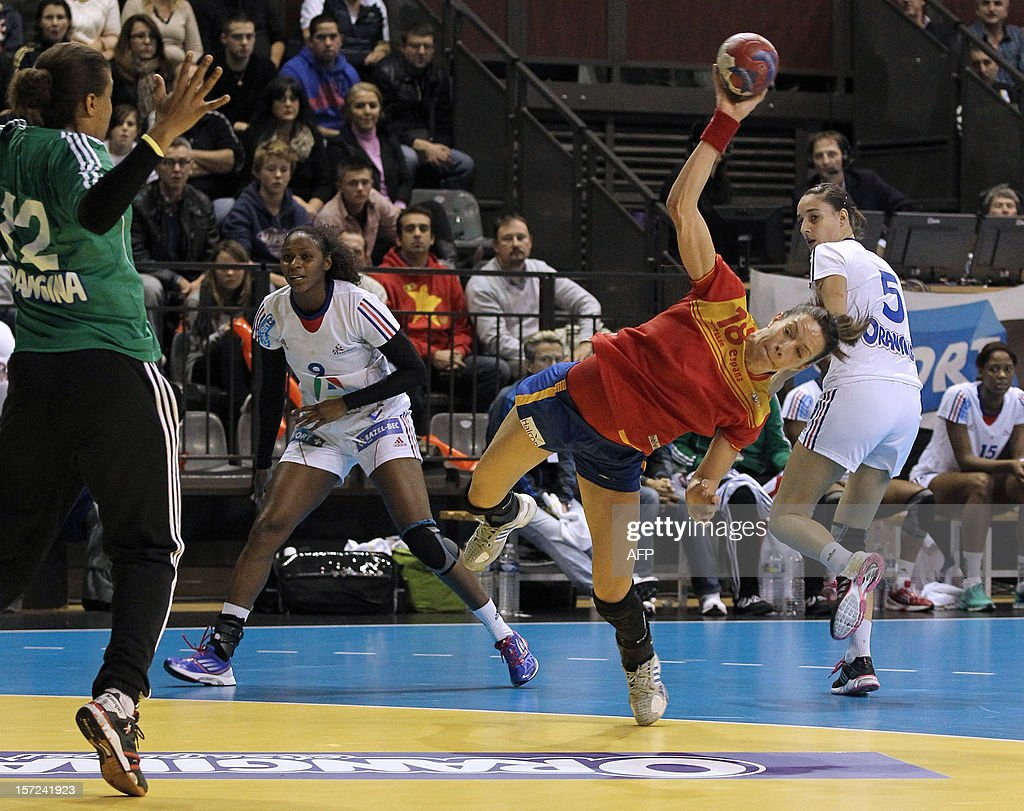 Spanish player Begona Fernandez (C) shoots during the friendly women's handball match France vs Spain, on November 30, 2012 at the Palais des victoires sports hall, in Cannes, southeastern France.