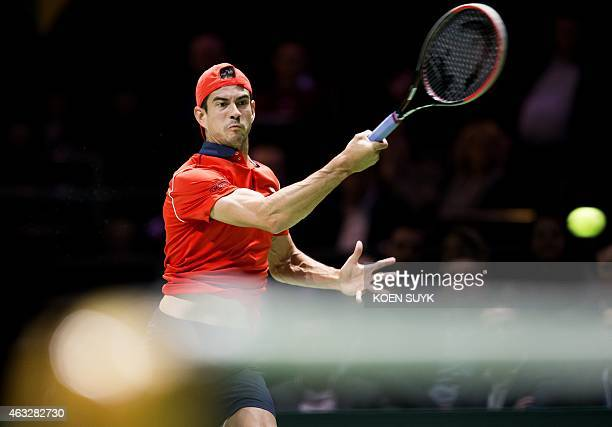 Spanish player Guillermo GarciaLopez returns the ball to Swiss player Stanislas Wawrinka during their tennis match at the ABN AMRO World Tennis...