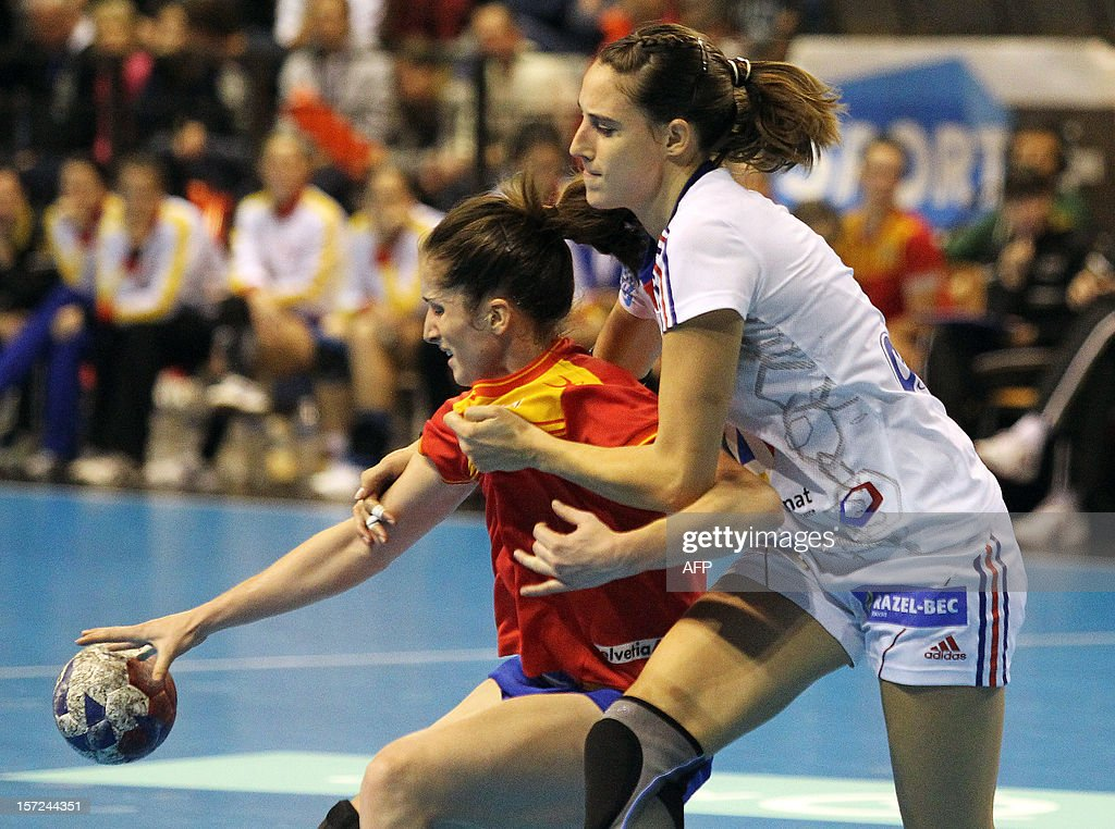 Spanish player Nerea Pena (L) fights for the ball with French player Camille Ayglon during the friendly women's handball match France vs Spain, on November 30, 2012 at the Palais des victoires sports hall, in Cannes, southeastern France.
