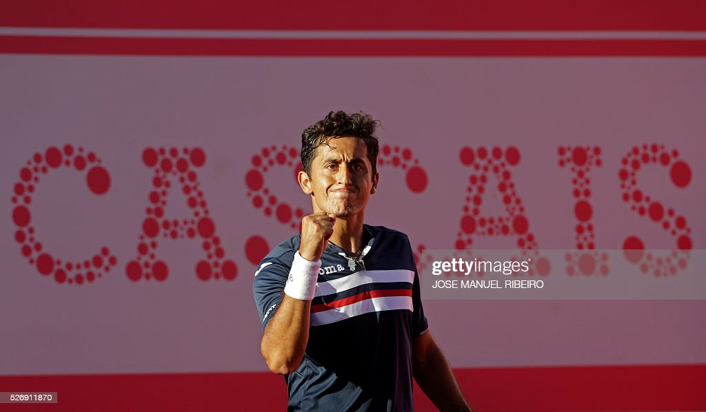 Spanish player Nicolas Almagro reacts after winning a point against his compatriot Pablo Carreno Busta during the Estoril Open Tennis tournament in Estoril on May 1, 2016. Almagro won 6-7, 7-6 and 6-3. / AFP / JOSE